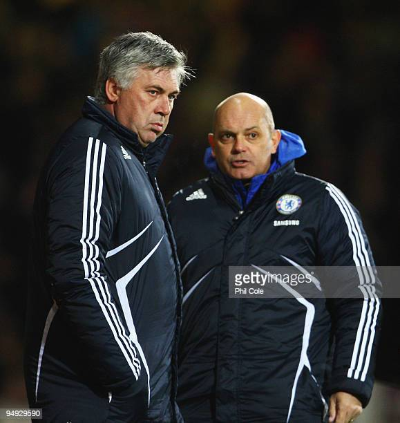 Carlo Ancelotti Manager of Chelsea talks with assistant Ray Wilkins during the Barclays Premier League match between West Ham United and Chelsea at...