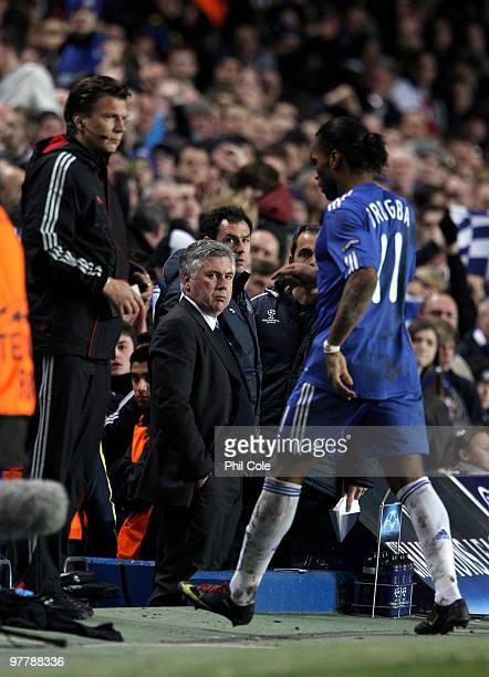 Carlo Ancelotti Manager of Chelsea watches Didier Drogba of Chelsea leave the field after he was sent off during the UEFA Champions League Round of...