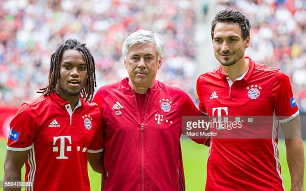 Carlo Ancelotti Mats Hummels and Renato Sanches of FC Bayern Munich pose before a a training session starts at Allianz Arena on August 6 2016 in...