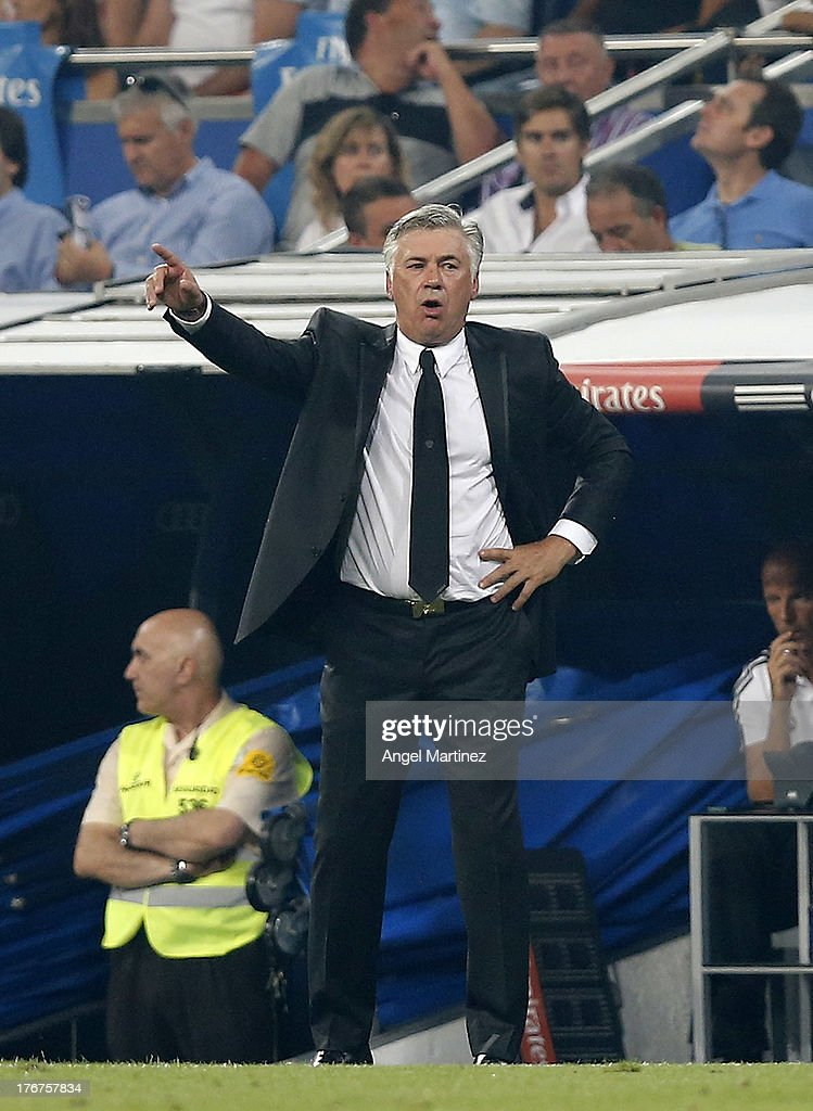 <a gi-track='captionPersonalityLinkClicked' href=/galleries/search?phrase=Carlo+Ancelotti&family=editorial&specificpeople=226747 ng-click='$event.stopPropagation()'>Carlo Ancelotti</a> of Real Madrid gives instructions during the La Liga match between Real Madrid CF and Real Betis at Estadio Santiago Bernabeu on August 18, 2013 in Madrid, Spain.