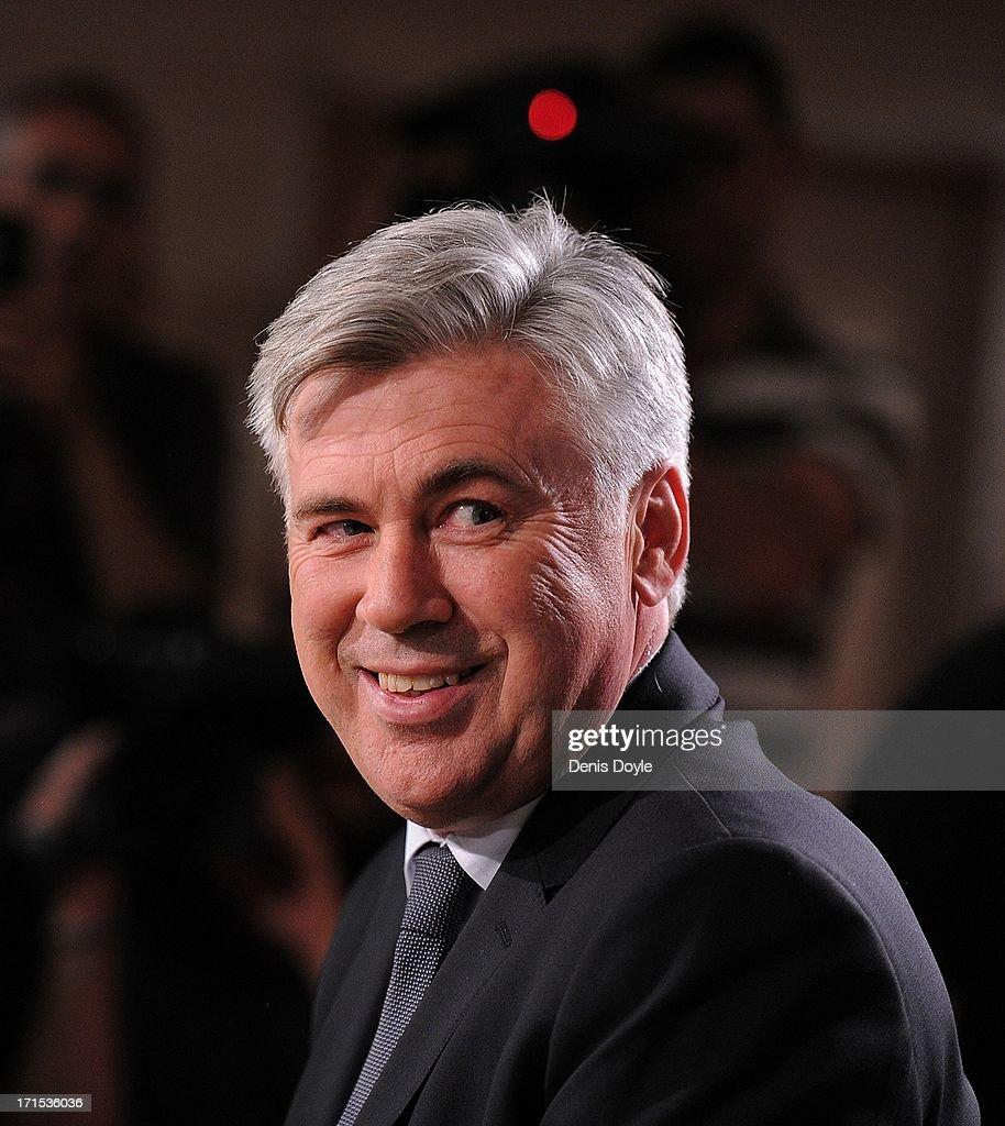 <a gi-track='captionPersonalityLinkClicked' href=/galleries/search?phrase=Carlo+Ancelotti&family=editorial&specificpeople=226747 ng-click='$event.stopPropagation()'>Carlo Ancelotti</a> smiles as he attends a press conference where he was presented as the new head coach of Real Madrid at Estadio Bernabeu on June 26, 2013 in Madrid, Spain.