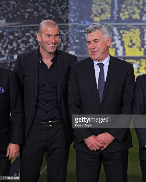 Carlo Ancelotti smiles as he stands alongside former player Zinedine Zidane during his presentation as the new head coach of Real Madrid at Estadio...