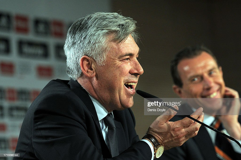<a gi-track='captionPersonalityLinkClicked' href=/galleries/search?phrase=Carlo+Ancelotti&family=editorial&specificpeople=226747 ng-click='$event.stopPropagation()'>Carlo Ancelotti</a> (L) smiles with former Real Madrid player <a gi-track='captionPersonalityLinkClicked' href=/galleries/search?phrase=Emilio+Butragueno&family=editorial&specificpeople=746497 ng-click='$event.stopPropagation()'>Emilio Butragueno</a> during a press conference after he was presented as Real Madrid's new head coach at Estadio Bernabeu on June 26, 2013 in Madrid, Spain.