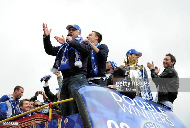 Carlo Ancelotti the Chelsea coach sings to the crowd during the Chelsea FC Victory Parade on May 16 2010 in London England