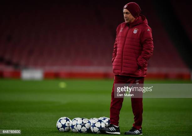 Carlo Ancelotti the head coach of Bayern Muenchen watches over his players during the FC Bayern Muenchen training session at the Emirates Stadium on...
