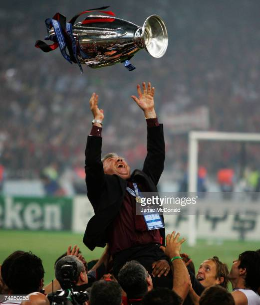 Carlo Ancelotti the manager of AC Milan tosses the trophy into the air in celebration following his teams 21 victory during the UEFA Champions League...