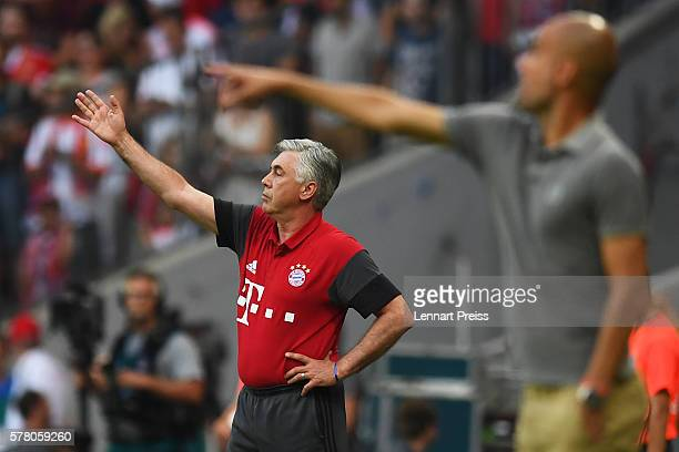 Carlo Ancelotti the manager of Bayern Munich and Pep Guardiola the manager of Manchester City direct their players during the pre season friendly...