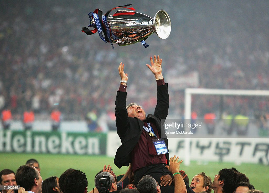 Carlo Ancelotti, the Milan manager throws the trophy in the air, whilst celebrating his teams 2-1 victoryduring the UEFA Champions League Final match between Liverpool and AC Milan at the Olympic Stadium on May 23, 2007 in Athens, Greece.