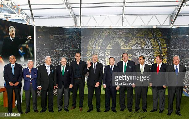 Carlo Ancelotti with the executive team of Real Madrid during his presentation as coach of Real Madrid at Estadio Santiago Bernabeu on June 26 2013...