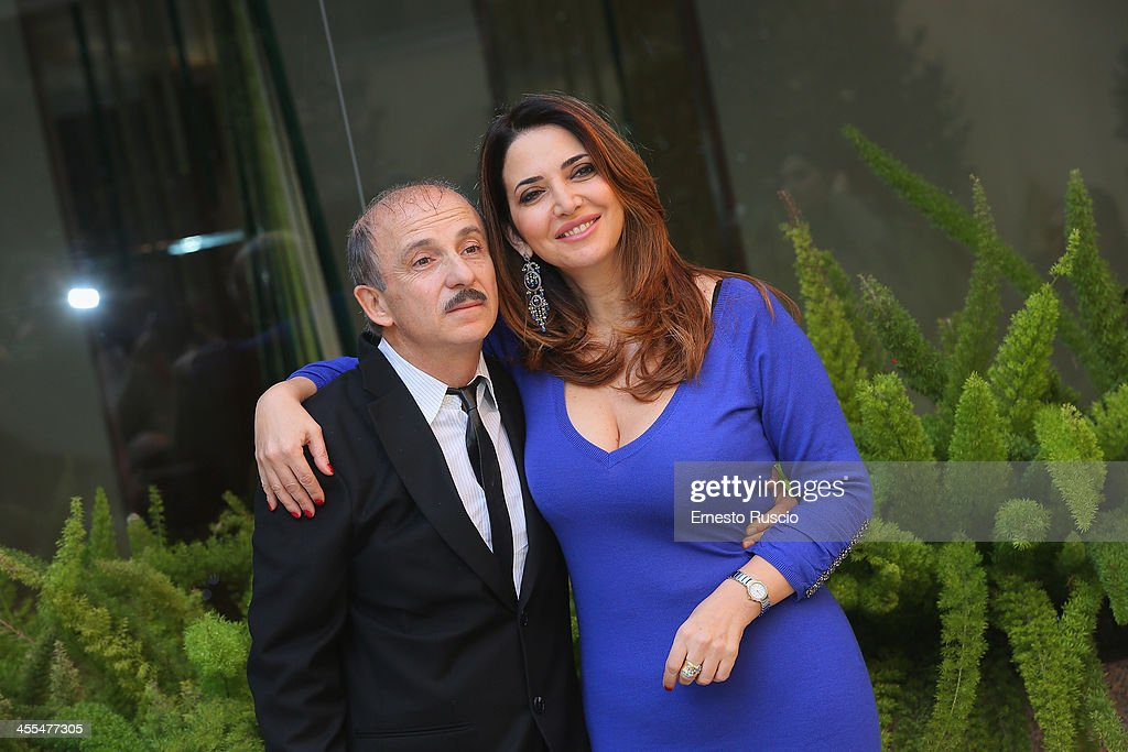 <a gi-track='captionPersonalityLinkClicked' href=/galleries/search?phrase=Carlo+Buccirosso&family=editorial&specificpeople=2092170 ng-click='$event.stopPropagation()'>Carlo Buccirosso</a> and Rosalia Porcaro attend the 'Indovina Chi Viene A Natale' Photocall at Hotel Visconti on December 12, 2013 in Rome, Italy.