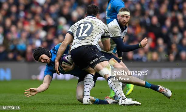 Carlo Canna of Italy is tackled by Alex Dunbar of Scotland during the RBS Six Nations match between Scotland and Italy at Murrayfield Stadium on...