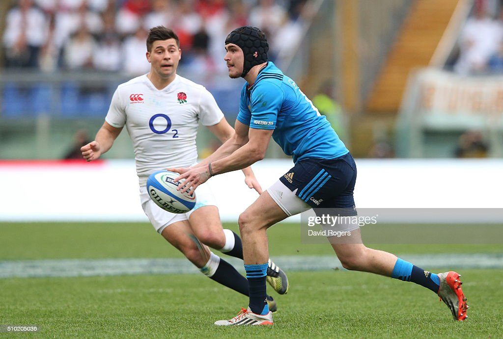 Carlo Canna of Italy passes as <a gi-track='captionPersonalityLinkClicked' href=/galleries/search?phrase=Ben+Youngs&family=editorial&specificpeople=3970947 ng-click='$event.stopPropagation()'>Ben Youngs</a> of England closes in during the RBS Six Nations match between Italy and England at the Stadio Olimpico on February 14, 2016 in Rome, Italy.