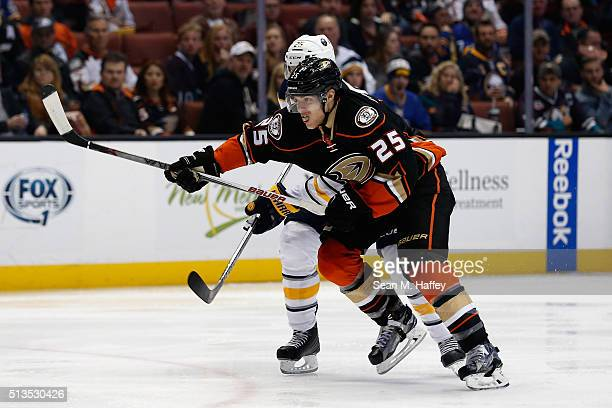 Carlo Colaiacovo of the Buffalo Sabres battles Mike Santorelli of the Anaheim Ducks for postion during the third period of a game at Honda Center on...