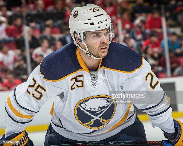 Carlo Colaiacovo of the Buffalo Sabres gets set for the faceoff during an NHL game against the Detroit Red Wings at Joe Louis Arena on December 1...