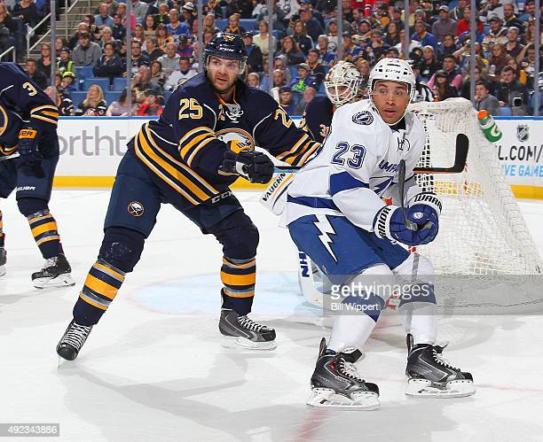 Carlo Colaiacovo of the Buffalo Sabres skates against JT Brown of the Tampa Bay Lightning on October 10 2015 at the First Niagara Center in Buffalo...