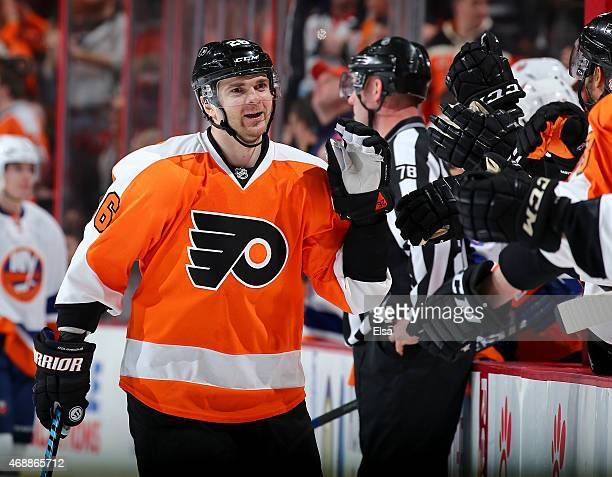 Carlo Colaiacovo of the Philadelphia Flyers celebrates his goal with teammates on the bench in the third period against the New York Islanders on...