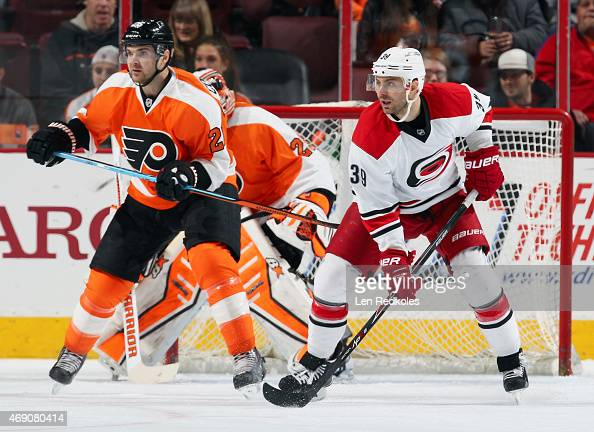 Carlo Colaiacovo of the Philadelphia Flyers defends goaltender Ray Emery against Patrick Dwyer of the Carolina Hurricanes on April 9 2015 at the...