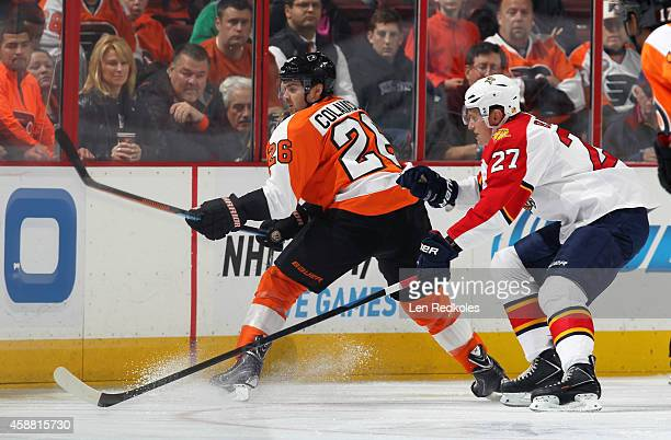 Carlo Colaiacovo of the Philadelphia Flyers in action against Nick Bjugstad of the Florida Panthers on November 6 2014 at the Wells Fargo Center in...