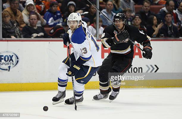Carlo Colaiacovo of the St Louis Blues is pursued by Teemu Selanne of the Anaheim Ducks for the puck in the third period at Honda Center on February...