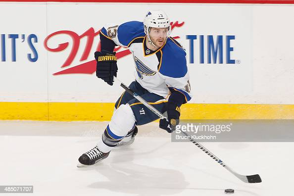 Carlo Colaiacovo of the St Louis Blues skates with the puck against the Minnesota Wild during the game on April 10 2014 at the Xcel Energy Center in...