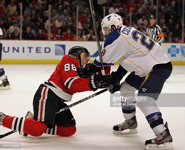 Carlo Colaiacovo of the St Louis Blues takes down Patrick Kane of the Chicago Blackhawks in the third period at the United Center on March 13 2012 in...