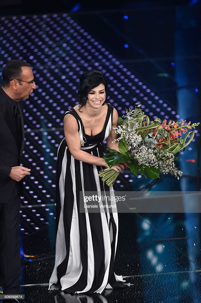 <a gi-track='captionPersonalityLinkClicked' href=/galleries/search?phrase=Carlo+Conti&family=editorial&specificpeople=4496663 ng-click='$event.stopPropagation()'>Carlo Conti</a> and Dolcenera attend second night of the 66th Festival di Sanremo 2016 at Teatro Ariston on February 10, 2016 in Sanremo, Italy.