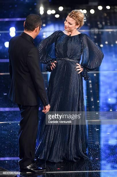 Carlo Conti and Emma Marrone attend the fourth night of 65th Festival di Sanremo 2015 at Teatro Ariston on February 13 2015 in Sanremo Italy