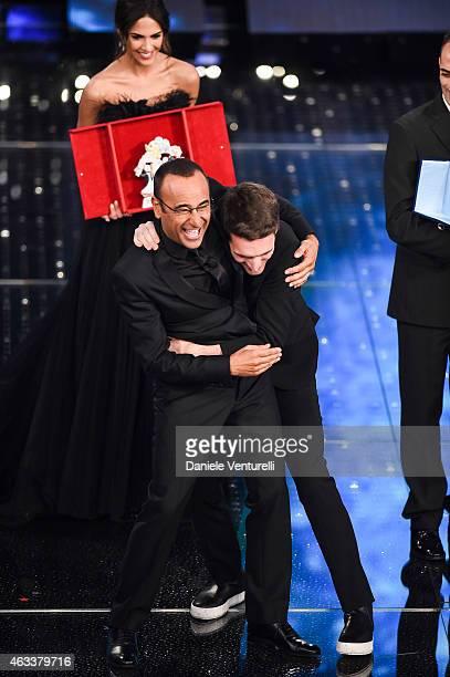 Carlo Conti and Giovanni Caccamo attend the Fourth night of 65th Festival di Sanremo 2015 at Teatro Ariston on on February 13 2015 in Sanremo Italy