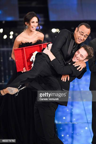 Carlo Conti and Giovanni Caccamo attend the Fourth night of 65th Festival di Sanremo 2015 at Teatro Ariston on on February 13 2015 in Sanremo Italy