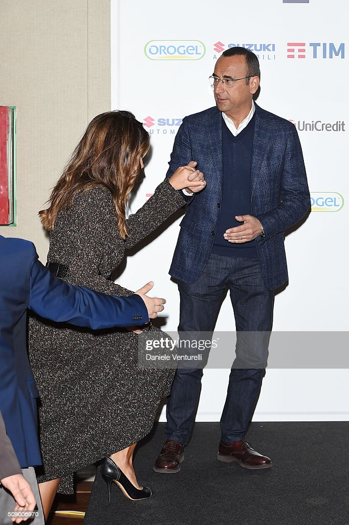 <a gi-track='captionPersonalityLinkClicked' href=/galleries/search?phrase=Carlo+Conti&family=editorial&specificpeople=4496663 ng-click='$event.stopPropagation()'>Carlo Conti</a> and Madalina Ghenea attend a photocall for 66. Sanremo Festival on February 8, 2016 in Sanremo, Italy.