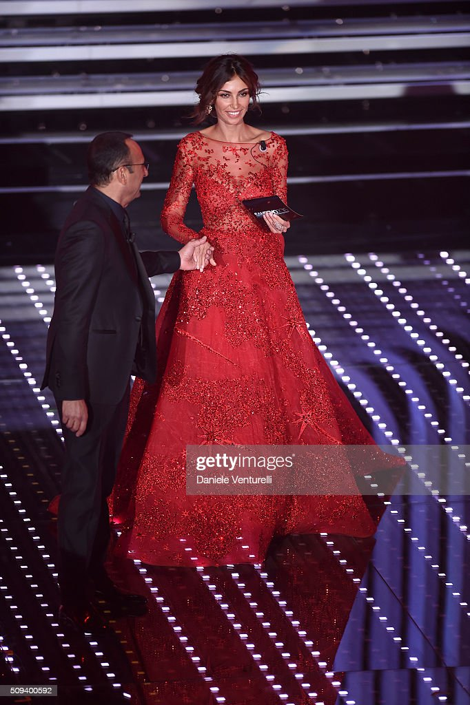 <a gi-track='captionPersonalityLinkClicked' href=/galleries/search?phrase=Carlo+Conti&family=editorial&specificpeople=4496663 ng-click='$event.stopPropagation()'>Carlo Conti</a> and Madalina Ghenea attend second night of the 66th Festival di Sanremo 2016 at Teatro Ariston on February 10, 2016 in Sanremo, Italy.