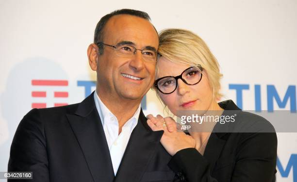 Carlo Conti and Maria De Filippi pose during the photocall of the 67th Italian Music Festival in Sanremo on February 6 2017 / AFP / Marco RAVAGLI