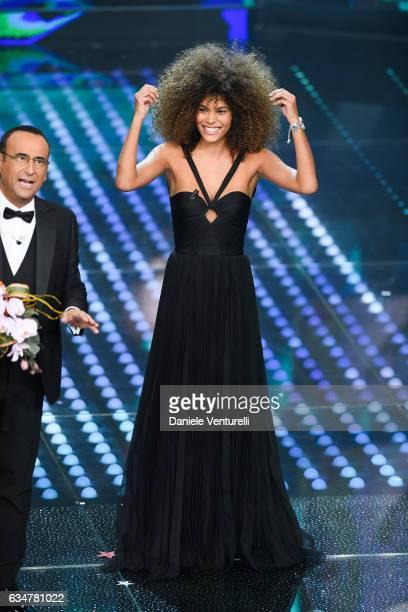 Carlo Conti and Tina Kunakey Di Vita attend the closing night of 67th Sanremo Festival 2017 at Teatro Ariston on February 11 2017 in Sanremo Italy