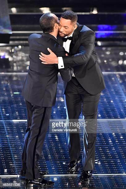 Carlo Conti and Will Smith attend the closing night of 65th Festival di Sanremo 2015 at Teatro Ariston on February 14 2015 in Sanremo Italy