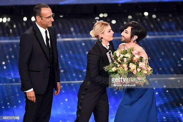 Carlo Conti Emma Marrone and Conchita Wurst attend second night 65th Festival di Sanremo 2015 at Teatro Ariston on February 11 2015 in Sanremo Italy