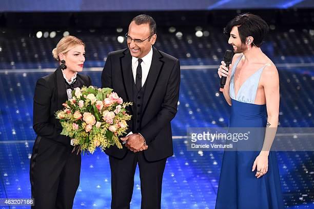 Carlo Conti Emma Marrone and Conchita Wurst attend second night 65th Festival di Sanremo 2015 at Teatro Ariston on February 11 2015 in Sanremo Italy