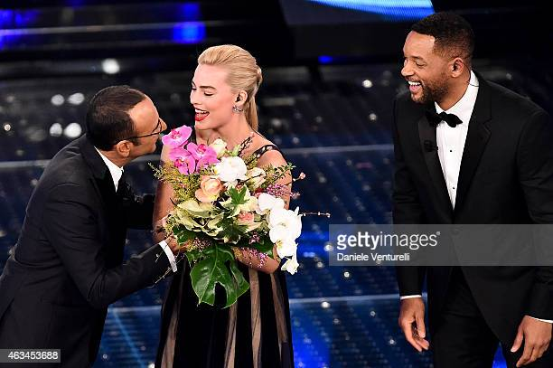 Carlo Conti Margot Robbie Will Smith attend the closing night of 65th Festival di Sanremo 2015 at Teatro Ariston on February 14 2015 in Sanremo Italy