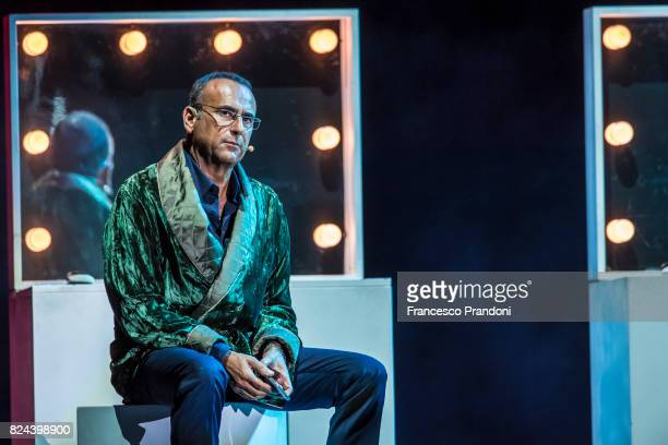 Carlo Conti of Panariello Conti Pieraccioni Show performs on stage during Lucca Summer Festival 2017 on July 29 2017 in Lucca Italy