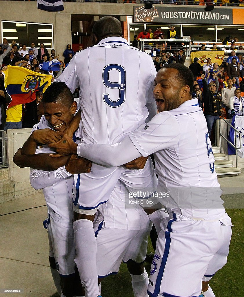 Carlo Costly #13 of Honduras reacts after scoring his second goal against Ecuador with <a gi-track='captionPersonalityLinkClicked' href=/galleries/search?phrase=Wilson+Palacios&family=editorial&specificpeople=2309103 ng-click='$event.stopPropagation()'>Wilson Palacios</a> #8, <a gi-track='captionPersonalityLinkClicked' href=/galleries/search?phrase=Maynor+Figueroa&family=editorial&specificpeople=882234 ng-click='$event.stopPropagation()'>Maynor Figueroa</a> #3, <a gi-track='captionPersonalityLinkClicked' href=/galleries/search?phrase=Jerry+Palacios&family=editorial&specificpeople=2532347 ng-click='$event.stopPropagation()'>Jerry Palacios</a> #9 and Víctor Bernárdez #5 during an international friendly match at BBVA Compass Stadium on November 19, 2013 in Houston, Texas.