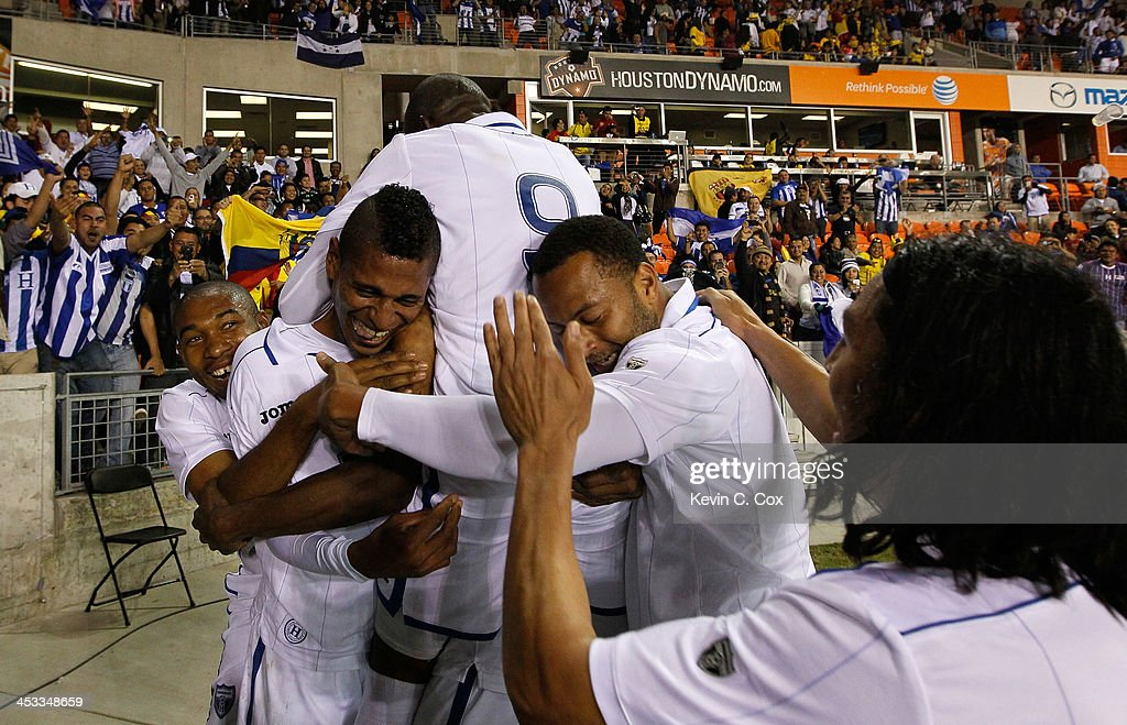 Carlo Costly #13 of Honduras reacts after scoring his second goal against Ecuador with <a gi-track='captionPersonalityLinkClicked' href=/galleries/search?phrase=Wilson+Palacios&family=editorial&specificpeople=2309103 ng-click='$event.stopPropagation()'>Wilson Palacios</a> #8, <a gi-track='captionPersonalityLinkClicked' href=/galleries/search?phrase=Maynor+Figueroa&family=editorial&specificpeople=882234 ng-click='$event.stopPropagation()'>Maynor Figueroa</a> #3, <a gi-track='captionPersonalityLinkClicked' href=/galleries/search?phrase=Jerry+Palacios&family=editorial&specificpeople=2532347 ng-click='$event.stopPropagation()'>Jerry Palacios</a> #9, Víctor Bernárdez #5 and <a gi-track='captionPersonalityLinkClicked' href=/galleries/search?phrase=Roger+Espinoza&family=editorial&specificpeople=4824201 ng-click='$event.stopPropagation()'>Roger Espinoza</a> #15 during an international friendly match at BBVA Compass Stadium on November 19, 2013 in Houston, Texas.