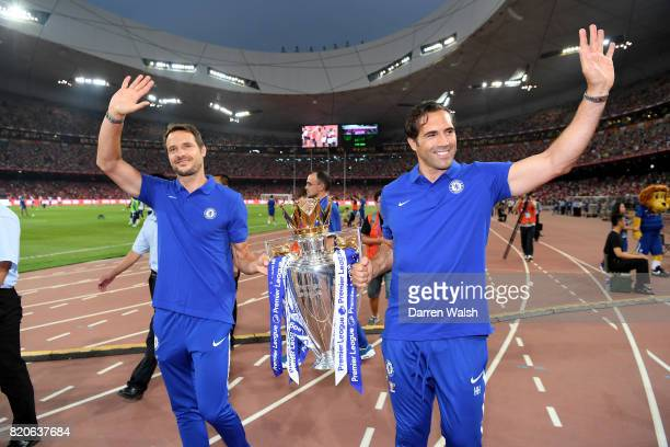 Carlo Cudicini assistant to first team head coach and Henrique Hilario assistant goalkeeper coach parade the Premier League Trophy around the pitch...