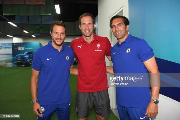 Carlo Cudicini assistant to first team head coach of Chelsea Petr Cech of Arsenal and Henrique Hilario assistant goalkeeper coach of Chelsea prior to...
