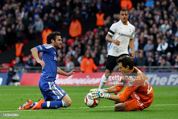 Carlo Cudicini of Tottenham Hotspur foils Juan Mata of Chelsea during the FA Cup with Budweiser Semi Final match between Tottenham Hotspur and...
