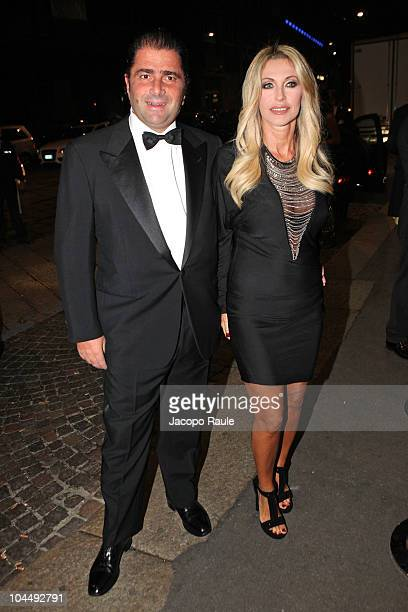 Carlo de Benedetti and Paola Ferrari are seen during Milan Fashion Week Womenswear S/S 2011 on September 26 2010 in Milan Italy