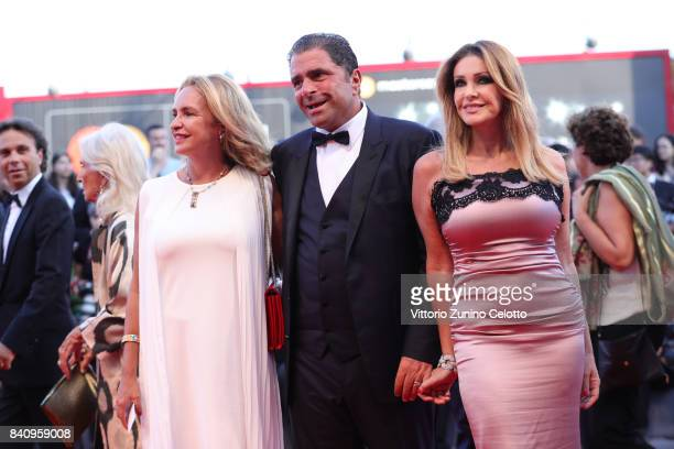 Carlo De Benedetti and Paola Ferrari walks the red carpet ahead of the 'Downsizing' screening and Opening Ceremony during the 74th Venice Film...