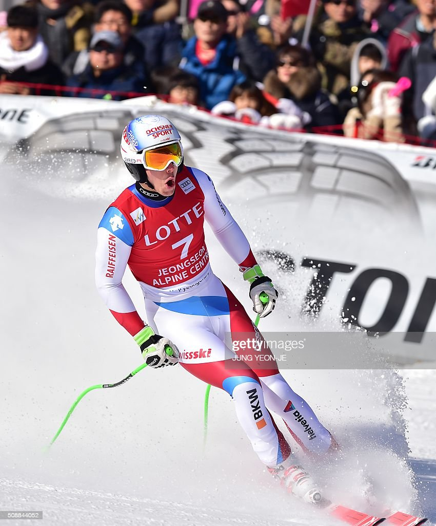 Carlo Janka of Switzerland arrives at the finish line during the 8th men's super G event at the FIS Alpine Ski World Cup at the Jeongseon Alpine Centre in Jeongseon county, some 150 kms east of Seoul, on February 7, 2016. The FIS Ski Men's World Cup runs from February 6 to 7 and is the first official test event for the Pyeongchang 2018 Winter Olympics. AFP PHOTO / JUNG YEON-JE / AFP / JUNG YEON-JE