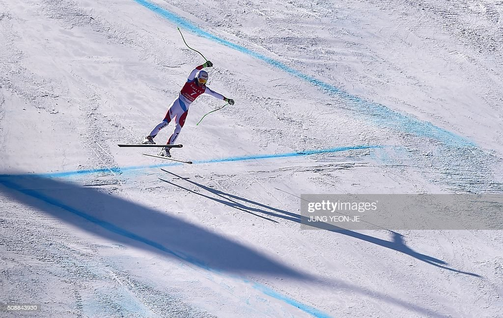 Carlo Janka of Switzerland jumps as he competes in the 8th men's super G event at the FIS Alpine Ski World Cup at the Jeongseon Alpine Centre in Jeongseon county, some 150 kms east of Seoul, on February 7, 2016. The FIS Ski Men's World Cup runs from February 6 to 7 and is the first official test event for the Pyeongchang 2018 Winter Olympics. AFP PHOTO / JUNG YEON-JE / AFP / JUNG YEON-JE