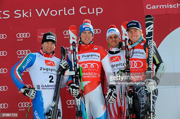 Carlo Janka of Switzerland with Davide Simoncelli of Italy Michael Gufler and Ted Ligety of USA takes first place during the Audi FIS Alpine Ski...
