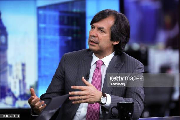 Carlo Messina chief executive officer of Intesa Sanpaolo SpA gestures while speaking during a Bloomberg Television interview in London UK on...