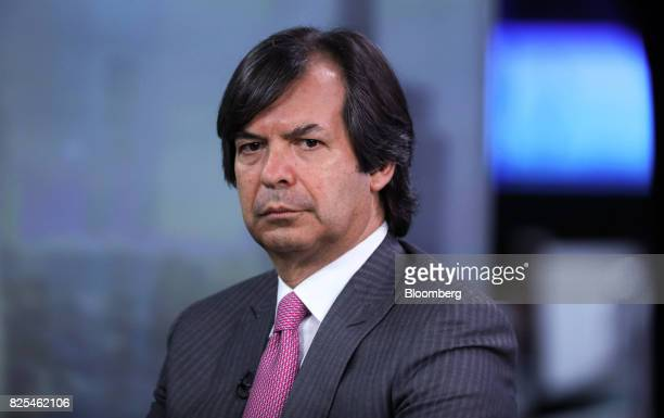 Carlo Messina chief executive officer of Intesa Sanpaolo SpA pauses during a Bloomberg Television interview in London UK on Wednesday Aug 2 2017...
